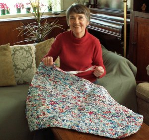 My mom is holding her partly finished milk bag mat