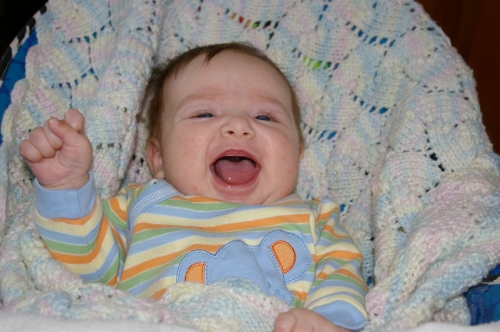 An adorable laughing baby