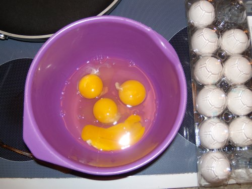 Egg yolks in a bowl resembling a smiley face