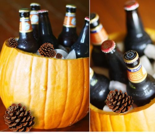 A hollowed-out pumpkin is used as an ice bucket for beer bottles.
