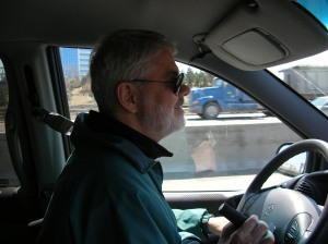 Man behind wheel of vehicle