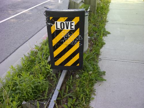 Traffic sign has the word LOVE added to it