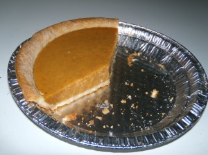 I tried to take a picture of a pumpkin pie that WASN'T half eaten, but that's an endangered species around here.