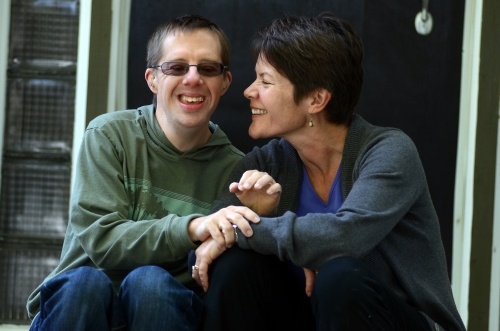 Karin and stepson Jim sharing a laugh, perhaps over the audacity of their plucky good deed. PHOTO BY HEATHER FRITZ