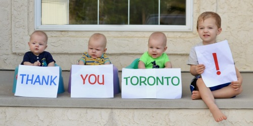 Here, the Lows' four beautiful sons show Toronto what they really think of it. (Photo courtesy of Leslie and Richard Low)