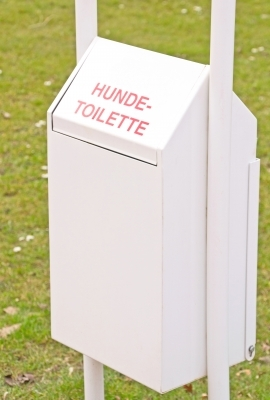 A dog waste receptacle in Germany. My question is, how do you keep your dog from wriggling while you hold his hind end over the bin? (Photo courtesy of Mister GC / FreeDigitalPhotos.net)