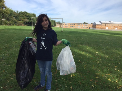 It's not all glamour. In her off hours – although I can't imagine she has many of them – Hannah isn't afraid to get her hands dirty. Here she is, picking up trash like a trouper. (Photo courtesy of the Alper family)